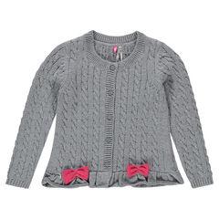 Gilet en tricot à côtes et torsades avec noeuds et volant