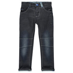Jeans coupe slim enduit effet used avec jeux de découpes et de surpiqûres