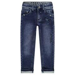 Jeans effet used et crinkle avec double taille élastiquée et broderies