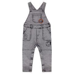 Salopette en jeans effet dévalé et used avec patch forme écusson