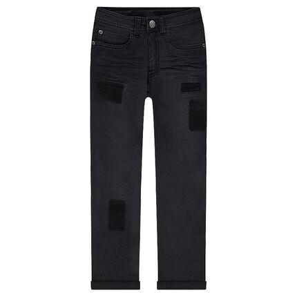 Jeans effet used et crinkle avec ombres de patchs