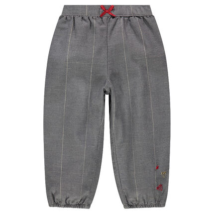 Pantalon à grands carreaux argentés et broderies contrastées