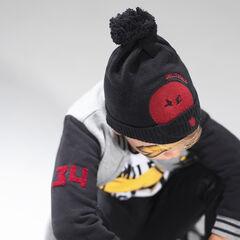 fdbd75aecbc Bonnet en tricot avec pompon et patch ©Smiley en feutrine