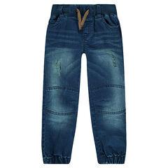 Jeans effet used avec chevilles élastiquées