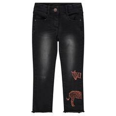 Jeans skinny effet used avec zèbre brodé