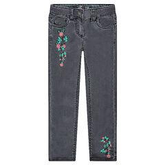 Jeans slim avec broderies fleurs