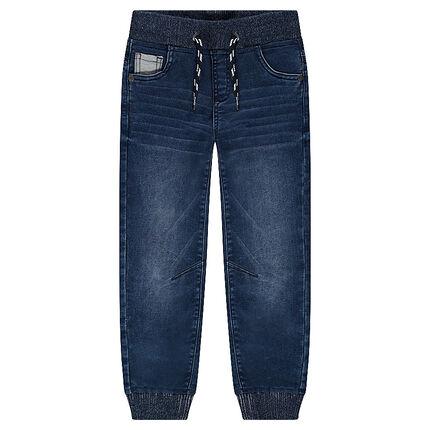 Jeans effet used avec taille et chevilles élastiquées