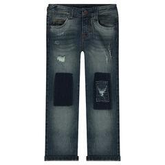 Jeans effet used et crinkle avec ombres et déchirures