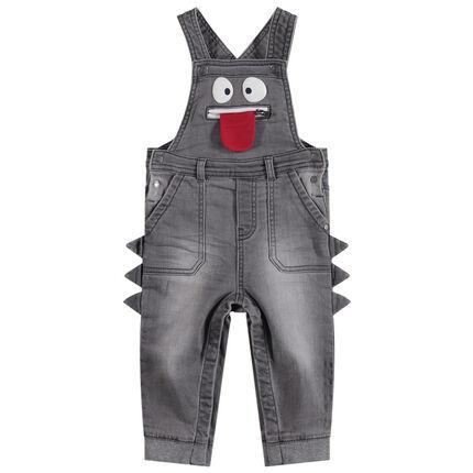 Salopette en jean effet used avec monstre patché et poche zippée