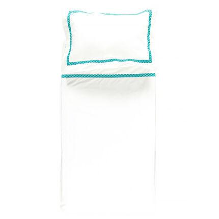 Drap et taie d'oreiller blanc et jeu d'imprimé pois