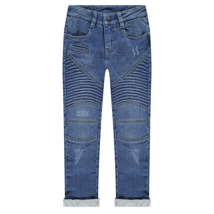 Jeans effet used et crinkle doublé jersey avec jeux de découpes