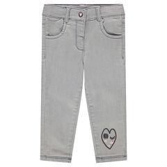 Jeans effet used avec coeurs en sherpa