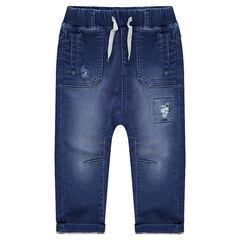 Jeans effet used avec taille élastiquée et baleine brodée au dos