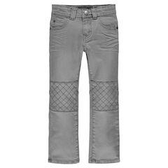 Jeans coupe slim avec jeux de découpes et de surpiqûres