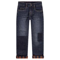 Jeans effet used et crinkle avec doublure en flanelle à carreaux