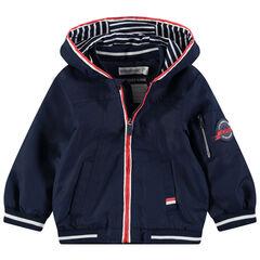 Coupe-vent uni avec doublure en jersey rayé et poches
