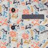 Polo manches courtes en piqué de coton imprimé avec touches de chambray