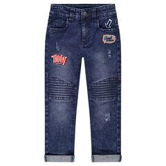 Jeans effet used avec badges patchés