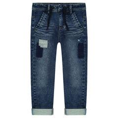 Jeans en molleton effet used avec patchs