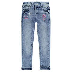 Jeans effet used avec strass fantaisie coupe slim