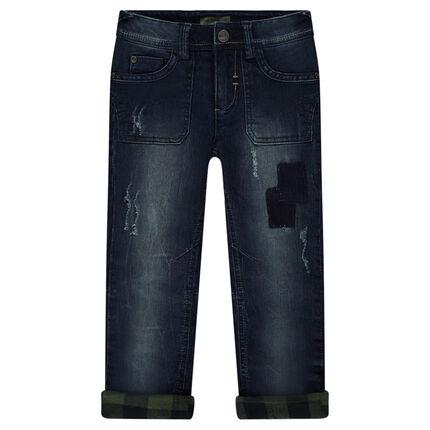 Jeans effet used doublé flanelle à carreaux