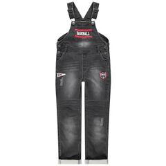 Salopette en jean effet used et crinkle avec prints et badges
