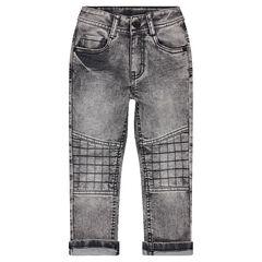 Jeans effet used avec jeux de surpiqûres et découpes