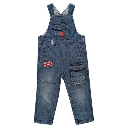 Salopette longue en jeans effet used et crinkle à poches et patchs