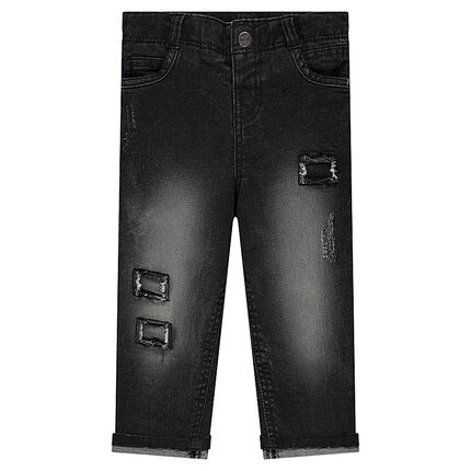 Jeans coupe slim à usures fantaisie