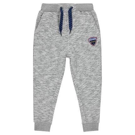 Pantalon de jogging fourche basse avec badge forme écusson