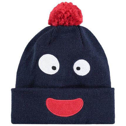Bonnet en tricot avec bouche et yeux brodés