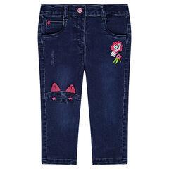 Jeans en moleton effet used avec broderies et découpe forme chat