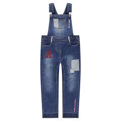 Salopette en jeans effet used avec badges fantaisie et broderies