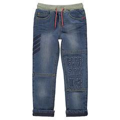 Jeans effet used doublé jersey élastiqué avec inscriptions en relief