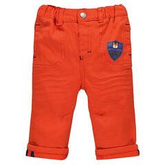 Pantalon en twill uni orange  à poches avec prints forme écusson et hibou