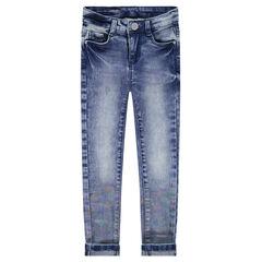 Jeans effet used avec enduction arc-en-ciel