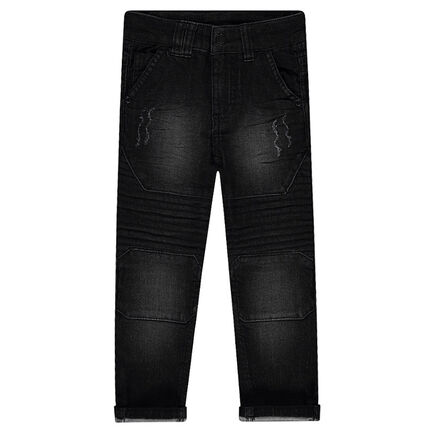 Jeans effet used et crinkle avec découpes