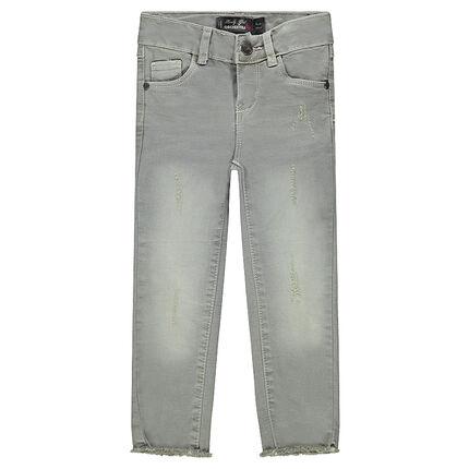 Jeans effet used avec déchirures fantaisie et franges