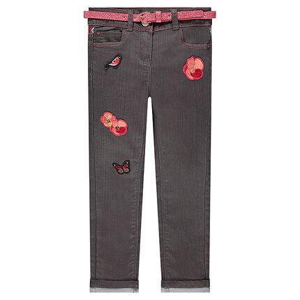 Jeans slim à ceinture pailletée et badges brodés
