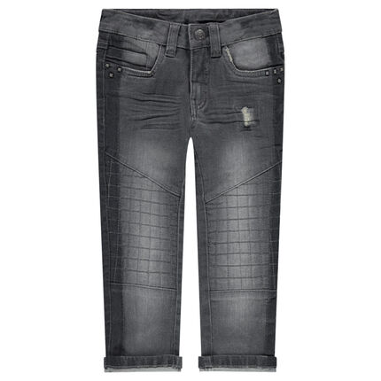 Jeans effet used et crinkle avec rivets fantaisie
