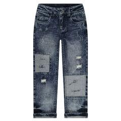 Jeans effet used et crinkle avec déchirures