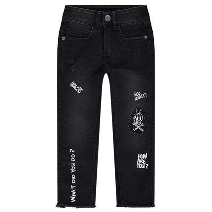 Jeans effet used avec textes printés et motif téléphone en relief au dos